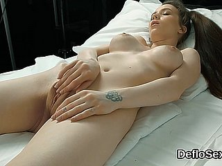Alluring cutie finger fucks spread twat until she is climaxing