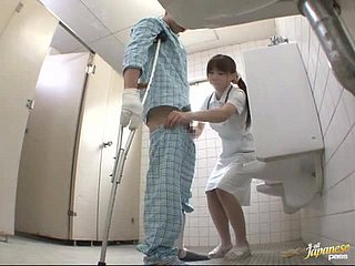 Horny Japanese nurse gives a handjob not far from eradicate affect patient