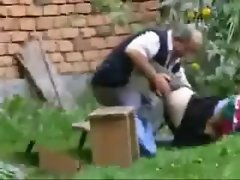 Russian granny with an increment of grandpa shacking up open-air